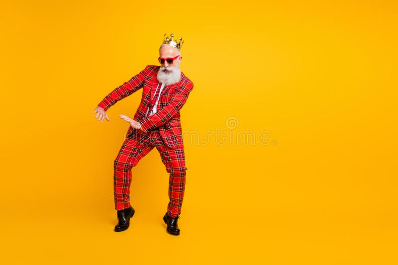 Full body photo of funny grandpa white beard dancing strange youngster moves little drunk wear crown sun specs gingham stock photography