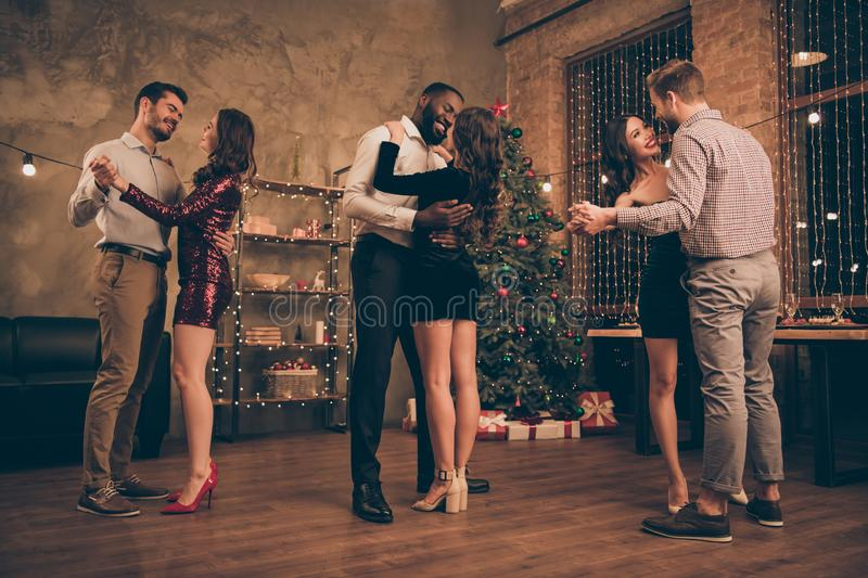 Full body photo of lovely men and women dancing romantic celebrate christmas party x-mas holidays in house with newyear royalty free stock photo