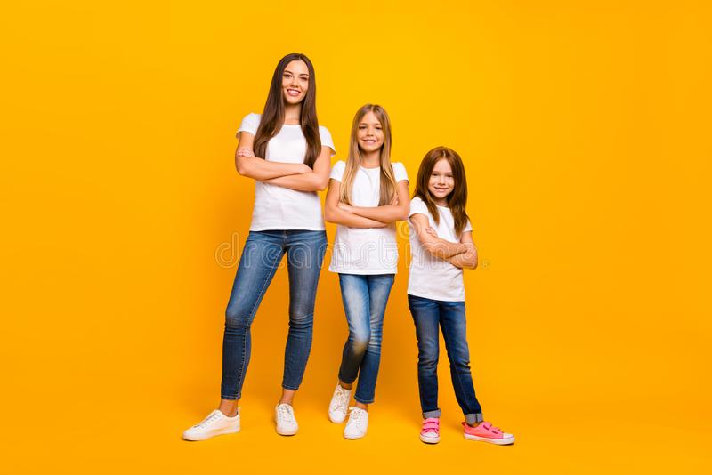 Full body photo of three sister ladies self-confident crossing arms wear casual outfit isolated yellow background royalty free stock images