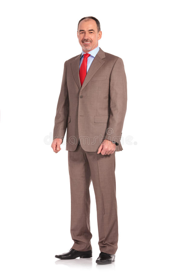 Full body picture of a mature senior businessman standing stock photo