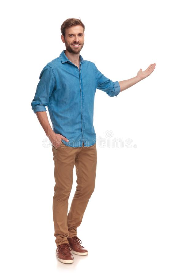 Free Full Body Picture Of A Young Casual Man Presenting Stock Photography - 125239382