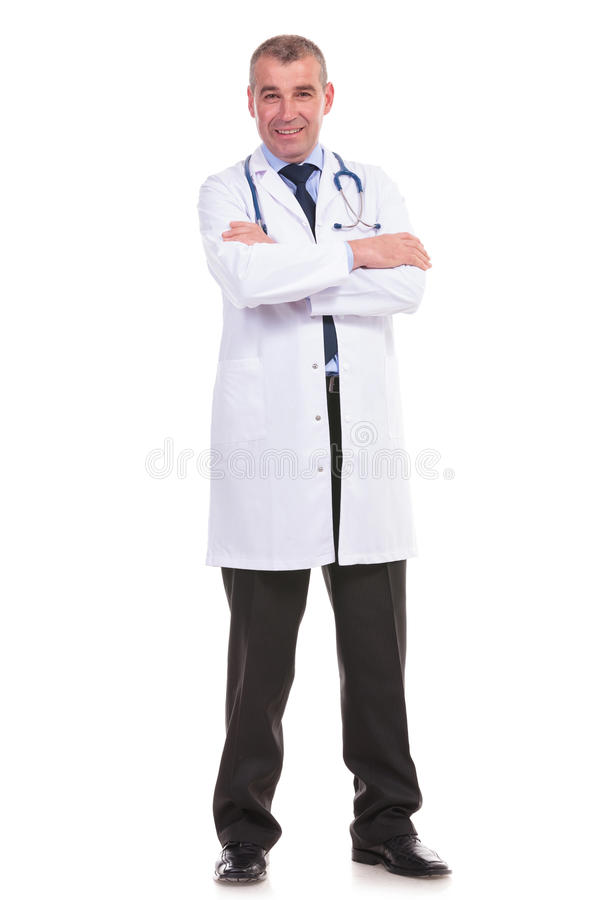 Full body picture of an old doctor with arms crossed royalty free stock image
