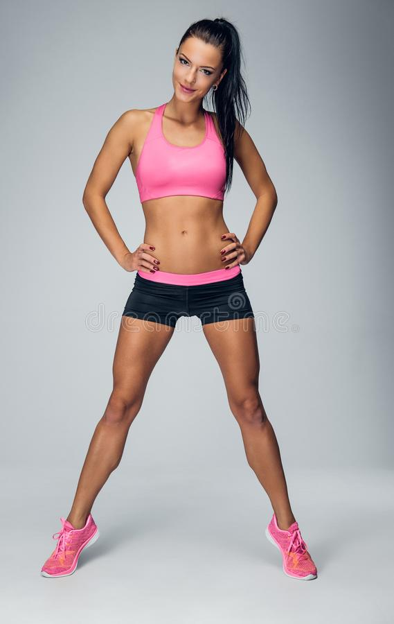 Full body portrait of athletic, fitness female. stock photo