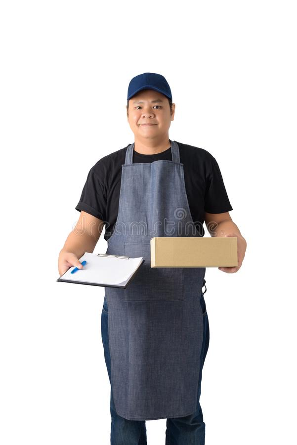 Full Body portrait of delivery man in Black shirt and apron with stack of boxes is carrying parcel and presenting receiving form. Isolated on the white stock image