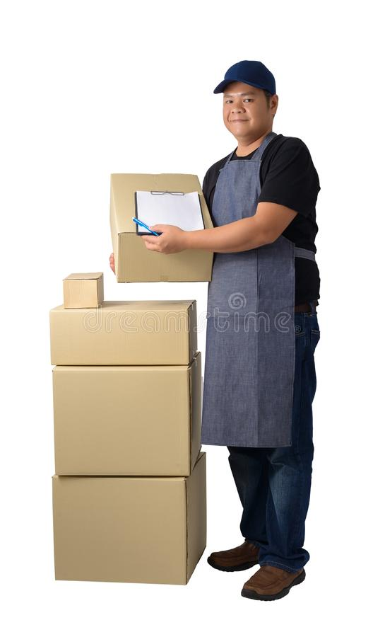 Delivery man in Black shirt and apron with stack of boxes is carrying parcel and presenting receiving form isolated. Full Body portrait of delivery man in Black stock photography