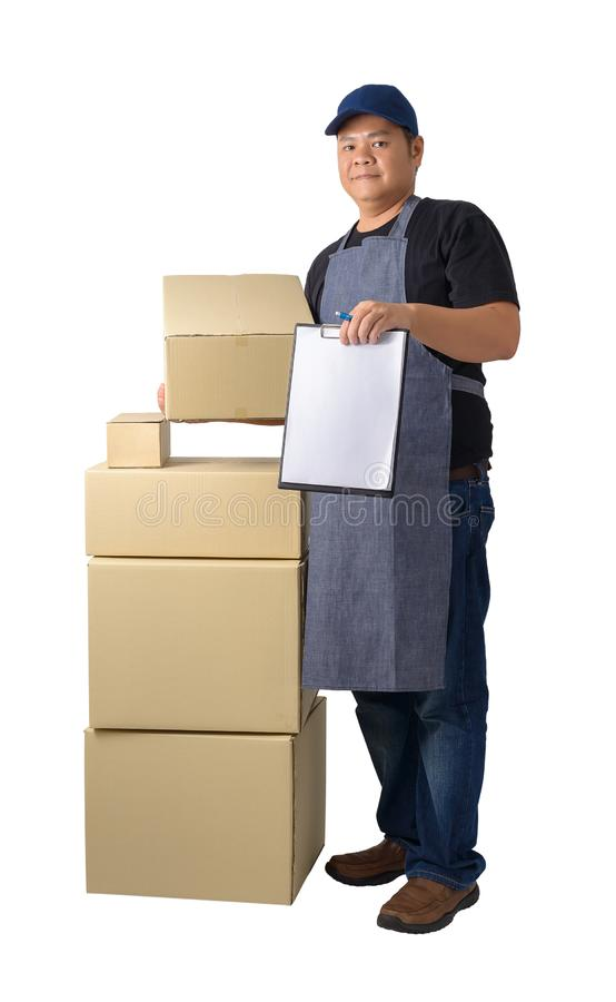 Delivery man in Black shirt and apron with stack of boxes is carrying parcel and presenting receiving form isolated. Full Body portrait of delivery man in Black stock photo