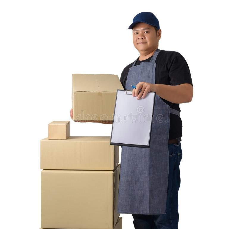 Delivery man in Black shirt and apron with stack of boxes is carrying parcel and presenting receiving form isolated. Full Body portrait of delivery man in Black stock images
