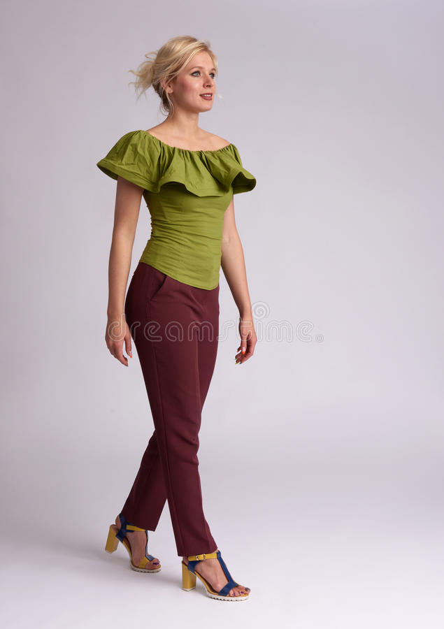 Full body portrait of fashionable pretty woman stock photography