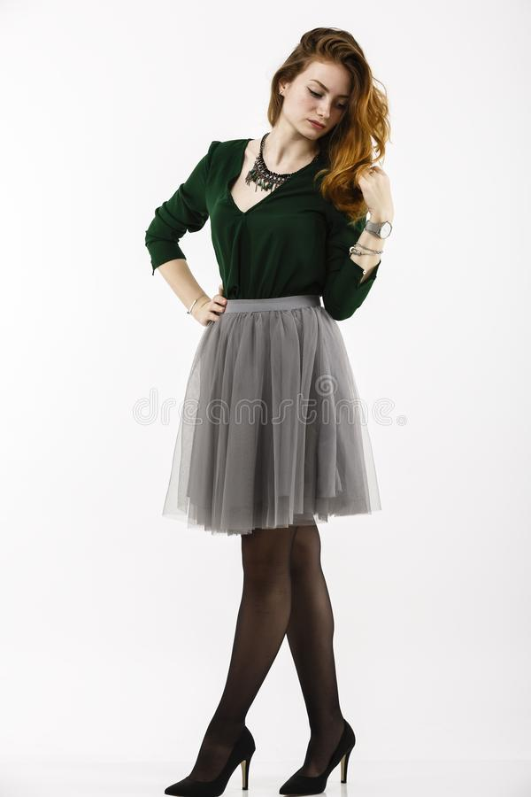 Full body portrait. With a beautiful redheaded woman stock photo