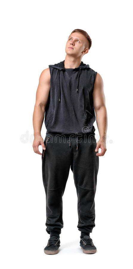 Full body portrait of handsome muscled young man looking up, isolated on white background royalty free stock images