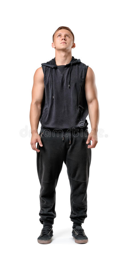Full body portrait of handsome muscled young man looking up, isolated on white background stock photography