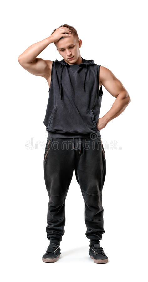 Full body portrait of handsome muscled young man thinking isolated on white background stock image