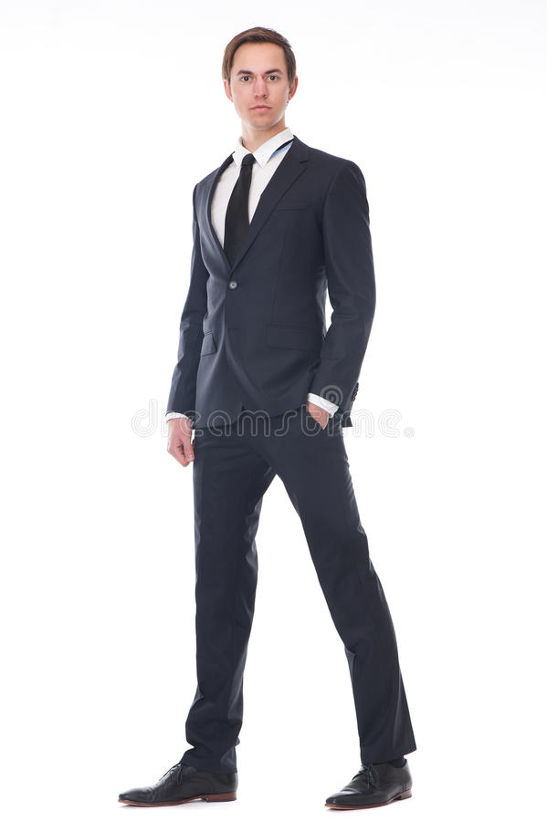 Full body portrait of a handsome young businessman in black suit. Isolated on white background royalty free stock images