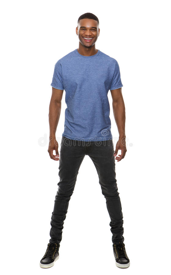 Full body portrait of a handsome young man smiling. Full body portrait of a handsome young african american man smiling on isolated white background stock images