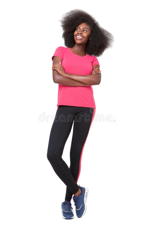 Full body happy african american sports woman standing against isolated white background stock photography