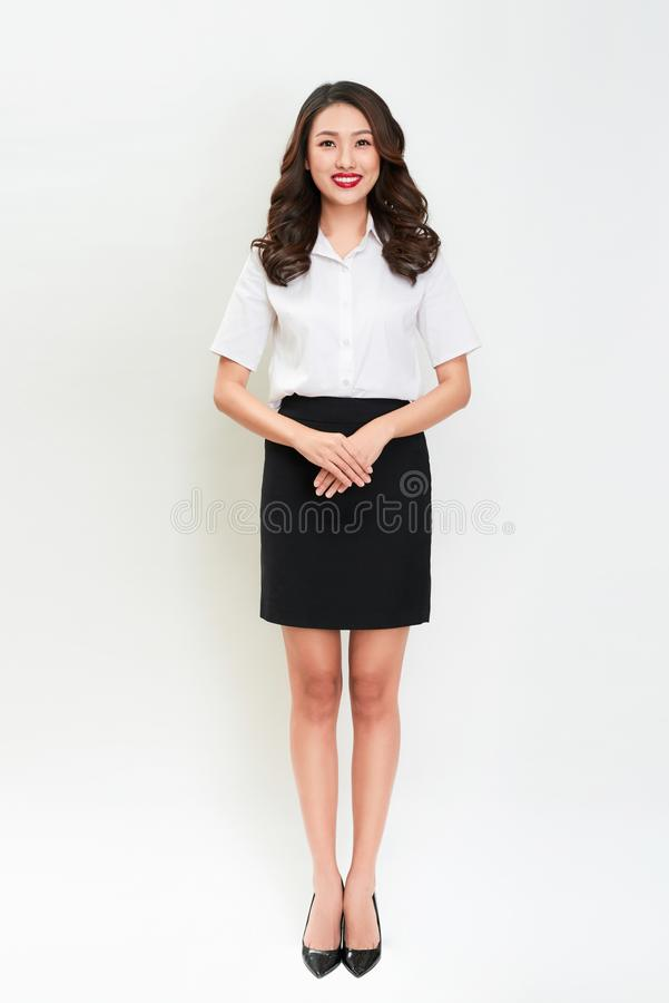 Full body portrait of happy smiling young beautiful business woman stock image