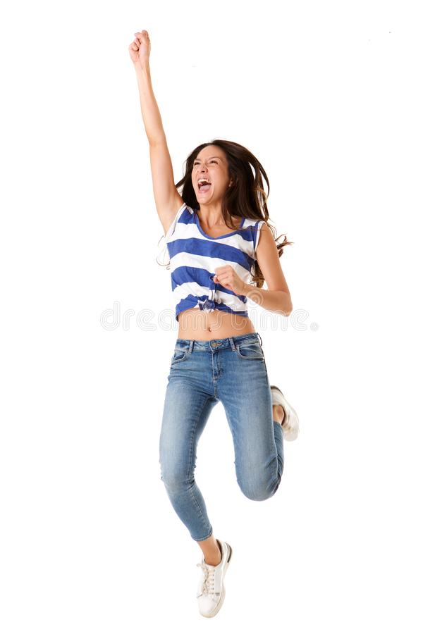 Full body joyful young asian woman jumping in the air against isolated white background royalty free stock photo