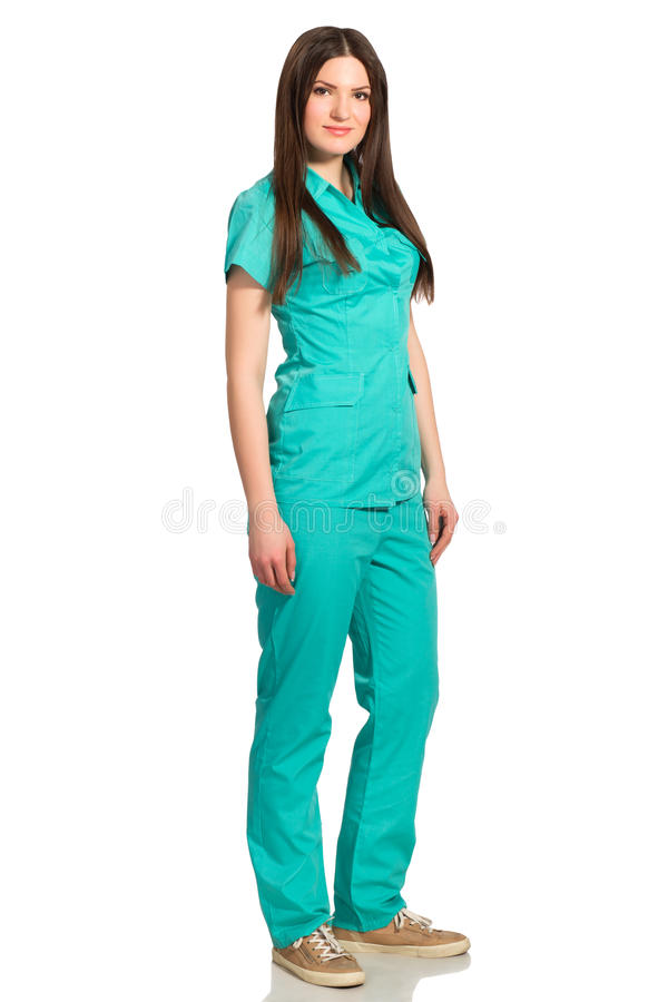 Full body portrait of nurse or young doctor in uniform royalty free stock photography