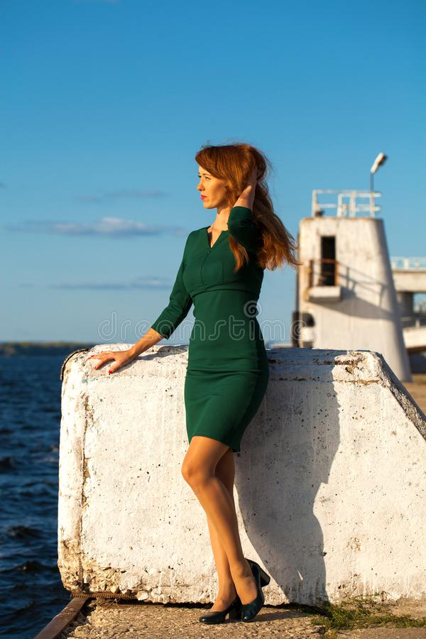 Full body portrait red-haired model. Full body portrait red-haired woman stock photo