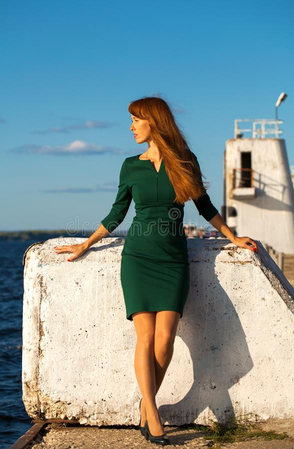 Full body portrait red-haired model. Full body portrait red-haired woman royalty free stock photo