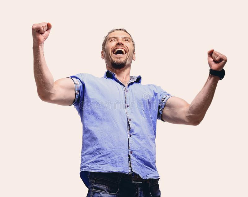 Full body portrait of relaxed mature man raising arms over white. Full body portrait of relaxed mature man raising arms stock images