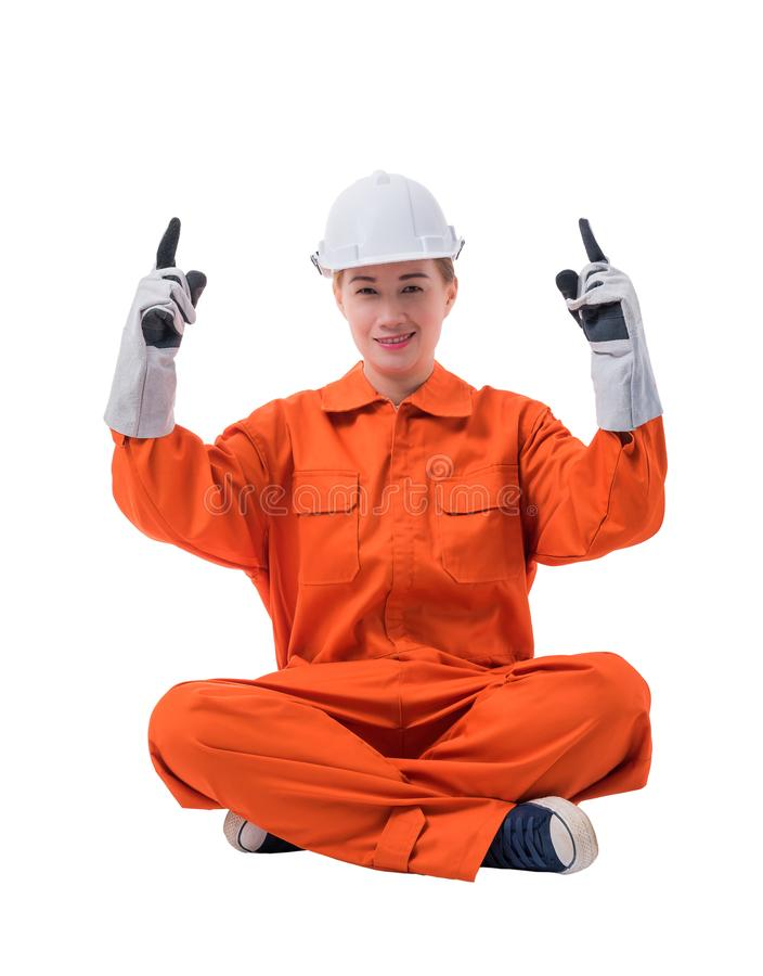 Full body portrait of a woman worker in Mechanic Jumpsuit is Sitting Finger up isolated on white background royalty free stock photography