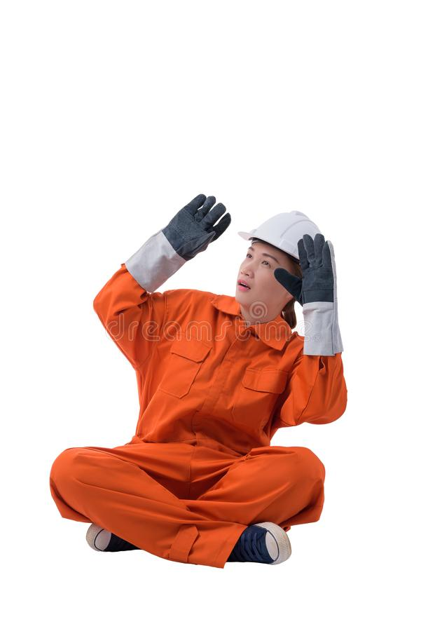 Full body portrait of a woman worker in Mechanic Jumpsuit is Sitting isolated on white background stock photo