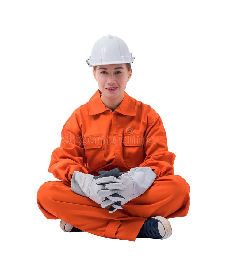 Full body portrait of a woman worker in Mechanic Jumpsuit is Sit royalty free stock image