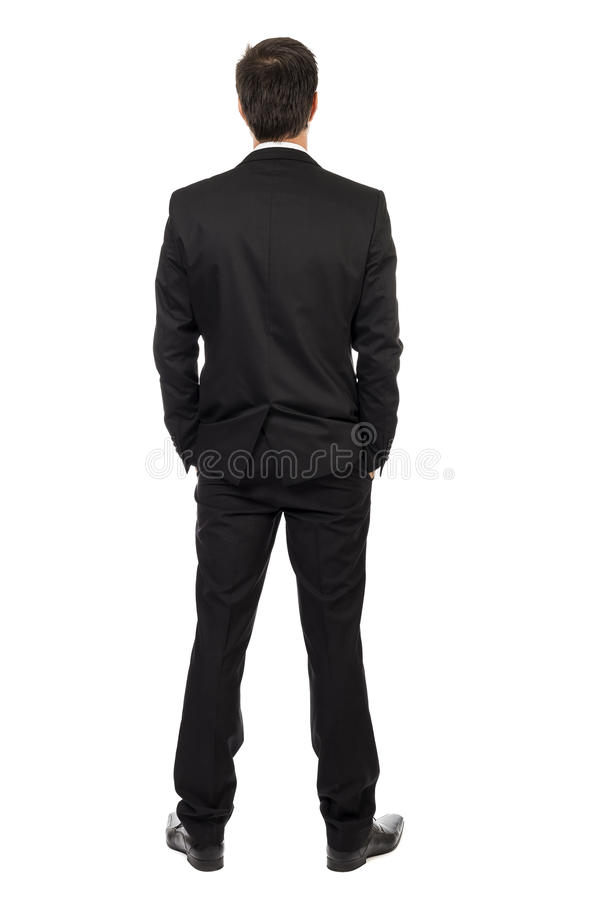 Full body portrait of young businessman, back view. With hands in pocket isolated over white background stock photo