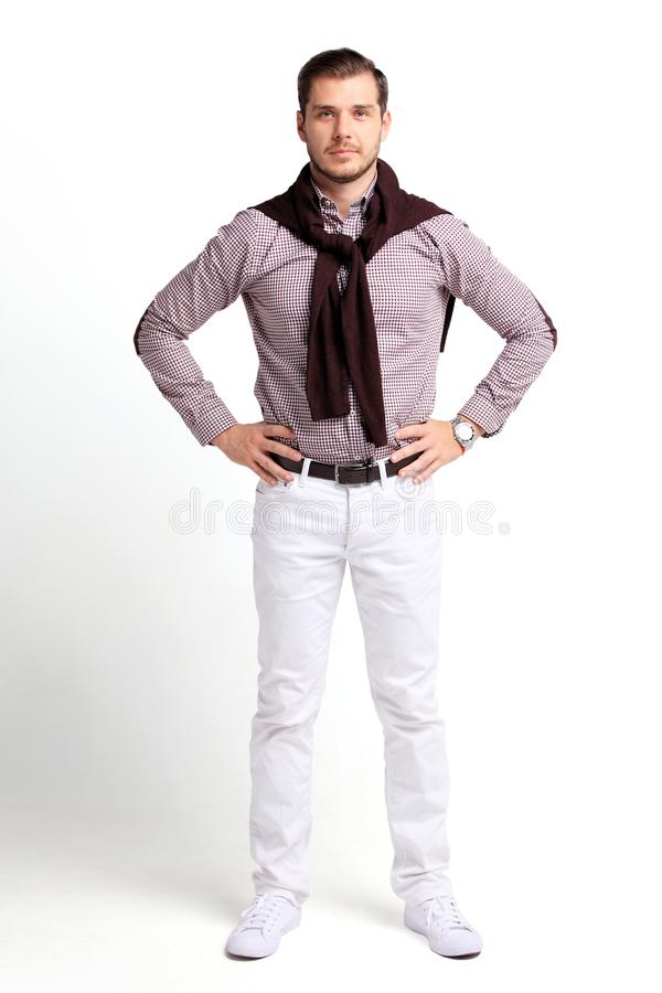 Full body portrait of young happy smiling cheerful business man, over white royalty free stock image