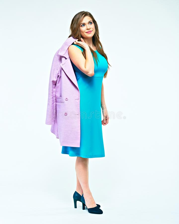 Full body portrait of young woman holding coat on shoulder. Stud. Io white background isolated royalty free stock image