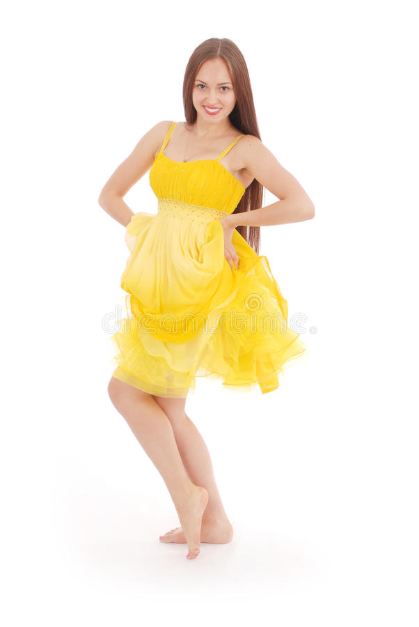 Full body portrait of young woman in yellow dress. stock photo