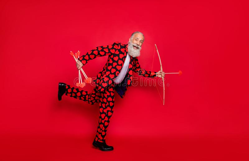 Full body profile photo of funky crazy aged guy cupid hobby love feelings couple shoot love bow arrow wear hearts. Full body profile photo of funky crazy aged stock images