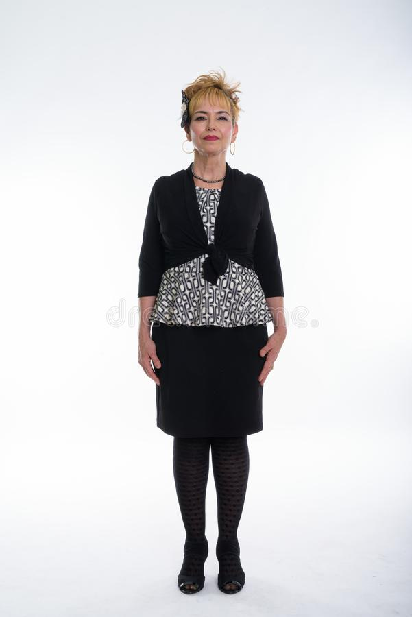 Full body shot of senior Asian businesswoman standing against wh royalty free stock image