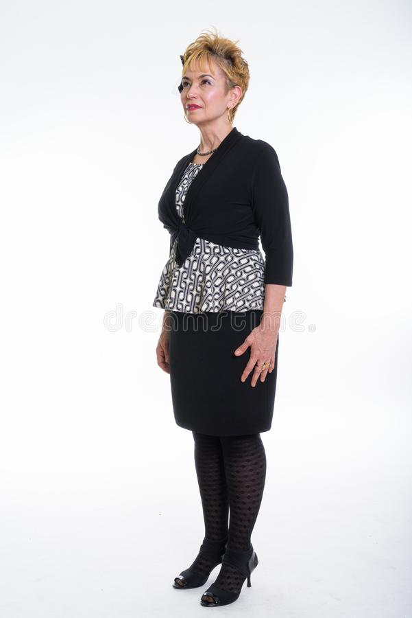 Full body shot of senior Asian businesswoman standing while thin. King against white background stock photography