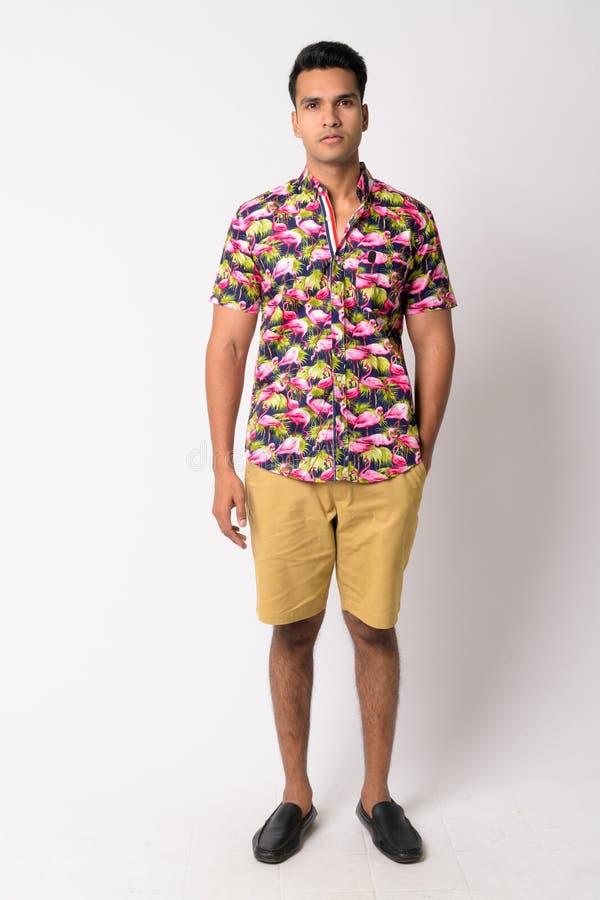 Full body shot of young Indian tourist man wearing bohemian shirt royalty free stock photos