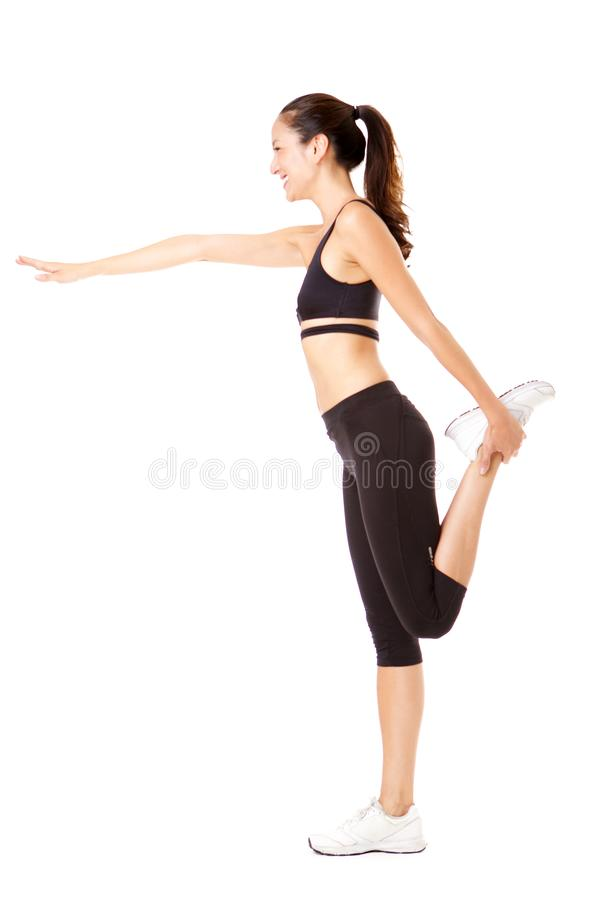 Side portrait of young asian woman doing yoga exercise against isolated white background stock images