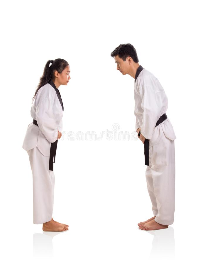 Female and male martial arts bow pose, side profile on white background royalty free stock image