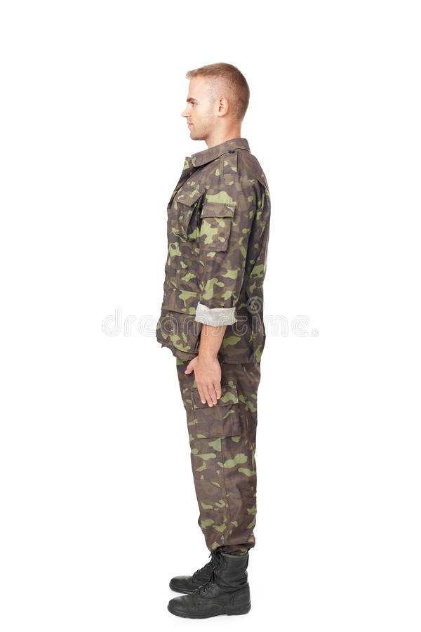 Full body side view of army soldier standing in attention stock photos