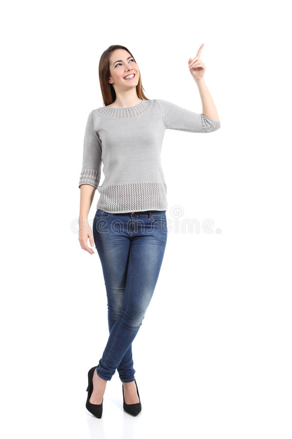 Full body of a standing casual woman pointing at side royalty free stock photography