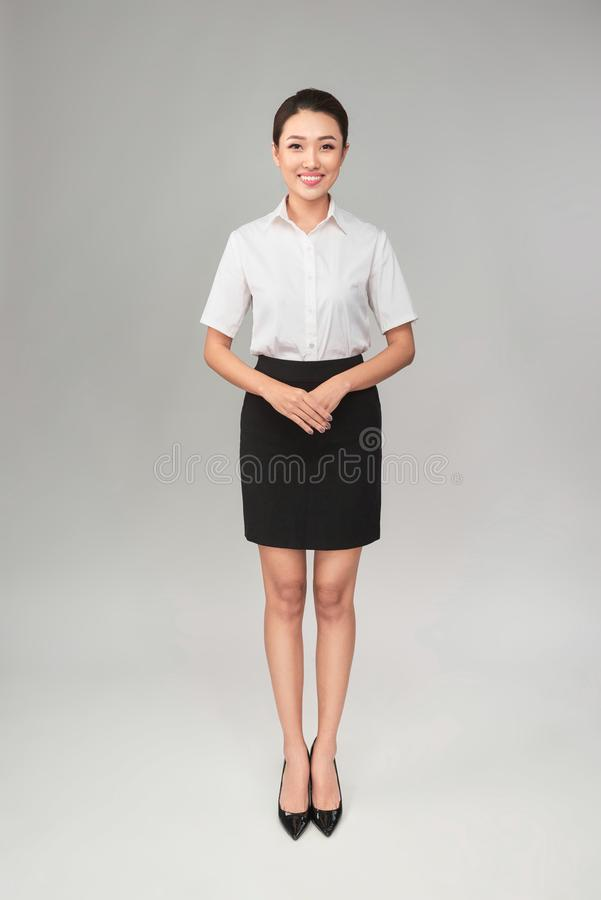 Full body studio shot of young beautiful business woman isolated on gray background royalty free stock images