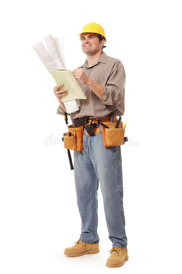Full body worker writing notes royalty free stock photography