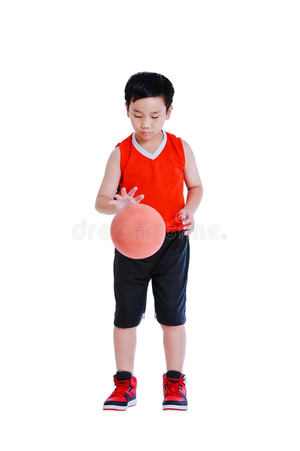 Full body of young asian boy playing with a basketball. Isolated royalty free stock images
