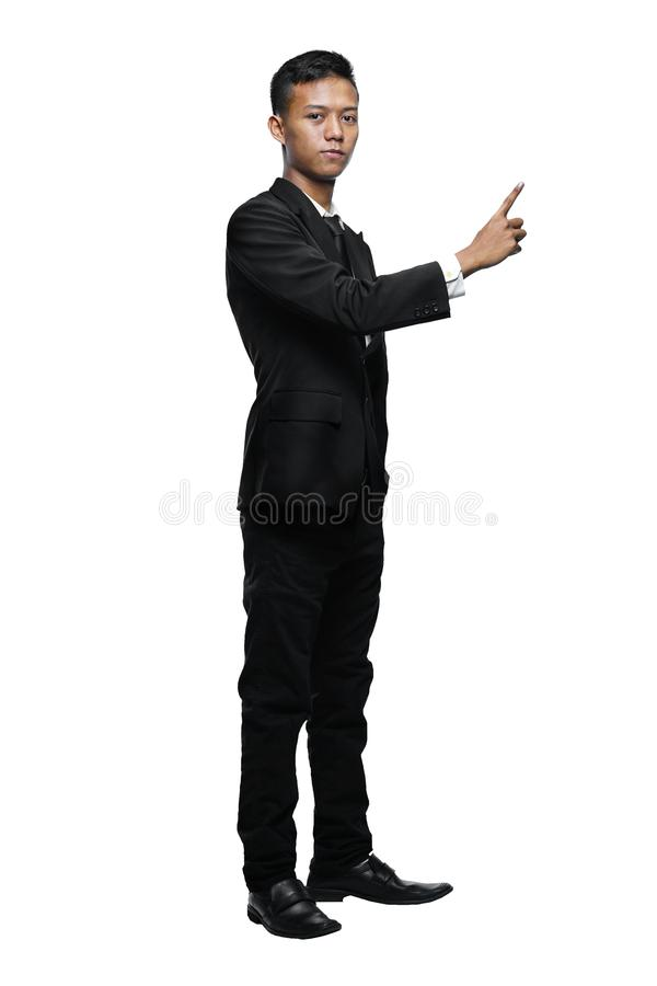 Full Body Young Asian Businessman Pointing Something royalty free stock images