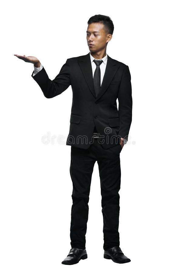 Full Body Young Asian Businessman Presenting Something stock images