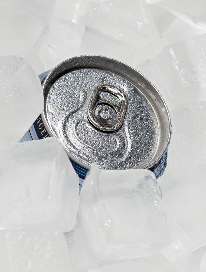 Full can beer or soda with drops of condensation. stock photos