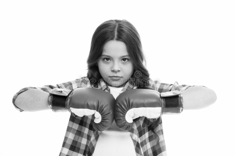 Full concentration. Girl concentrated training boxing gloves. Child concentrated face with sport gloves practice. Fighting skills isolated white. Girls power royalty free stock photo