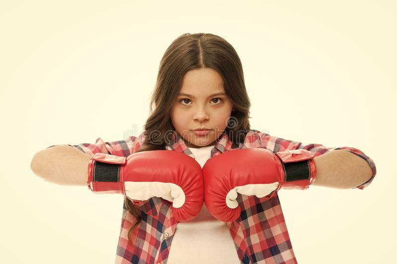 Full concentration. Girl concentrated training boxing gloves. Child concentrated face with sport gloves practice. Fighting skills isolated white. Girls power royalty free stock image