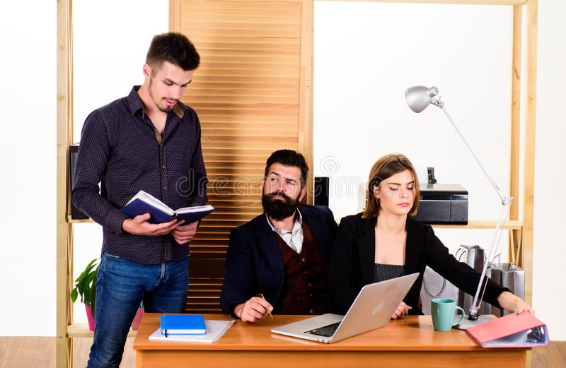 Full concentration at work. Professional people at work in office. Successful business men and woman using computer for royalty free stock images