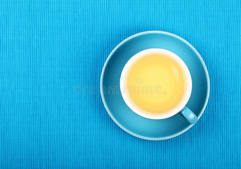 Full cup of green tea close up elevated top view stock photography
